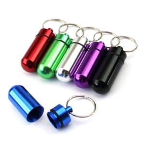 Gekleurde pillenkoker sleutelhanger - medicijnen - identiteitskoker waterdicht
